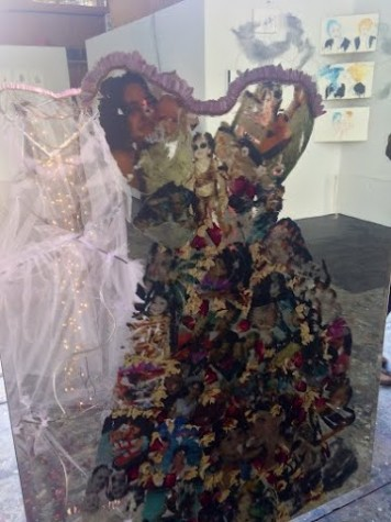 A metal dress with family photos attached welded by senior Olivia Black for her final project at Oxbow, based on ideas that had influenced her over time.