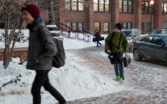 Students arrive to school in warm winter coats and hats in order to protect themselves from unforgiving temperatures.