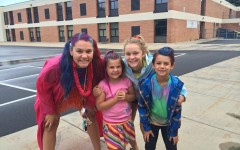 Sophomore Katie Brunell (right) with another counselor and two campers on Crazy Hair Day.