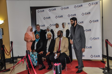 """Prominent CAIR contributors, including Joshua Salaam of Native Deen and Jaylani Hussain, the Executive Director of CAIR gather for a red carpet photo shortly after the 2015 Benefit gala ends. """"If you're new to CAIR,  going to the gala is a good educational opportunity to see what's going on [regarding civil rights in America],"""" sophomore Heba Sandozi said."""