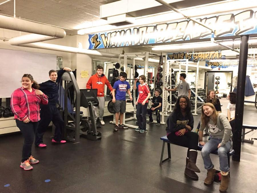 """Fitness for life students familiarize themselves with the equiptment on the first day of class. """"I'm excited to learn the CPR stuff. I saw the other classes do it and it looked like something that would be really fun,"""" freshman Robin Bartlett said."""