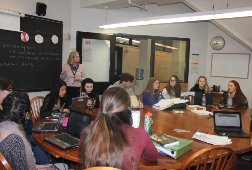 "Upper School History Teacher Nan Dreher teaches her senior spring elective, Women of History in the World on Jan. 29.  ""There are a lot of voices that don't get heard in history...[this course] is a start,"" senior Mattie Daub said."