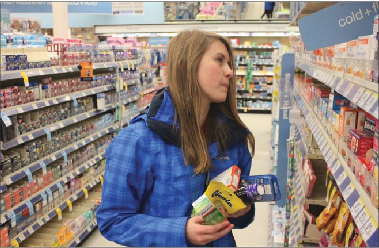 "Sophomore Sara Bohjanen browses flue remedies at Wallgreens. Cough drops, decongestents, and nasal sprays are all popular products come flu season. ""I don't really ever get sick and it's probably because I [get] my flu shot,""  Sophomore David Santos said."