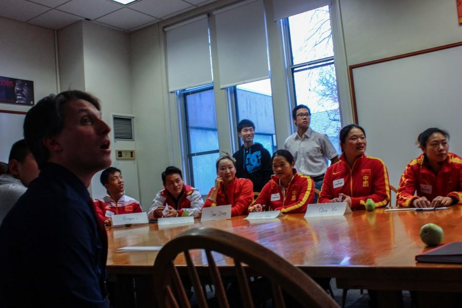 """Chinese athletes have a discussion with St. Paul Academy and Summit School students around a Harkness Table. """"The Chinese Athletes were really willing to answer the questions that we asked and they were interested in learning about our school too,"""" sophomore Soph Lundberg said."""