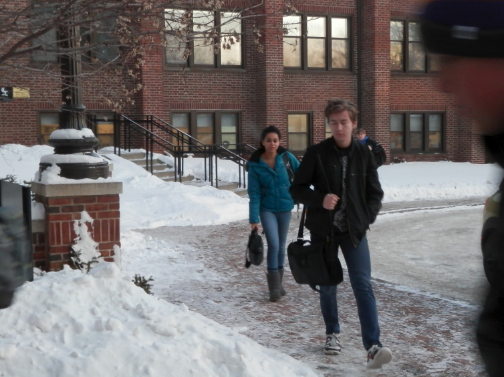 """Sophomore Meley Akpa and freshman Duke Nguyen walk into school in December on one of the coldest days of the year. """"The walk into school, even though it's short, is still really cold,"""" Akpa said."""