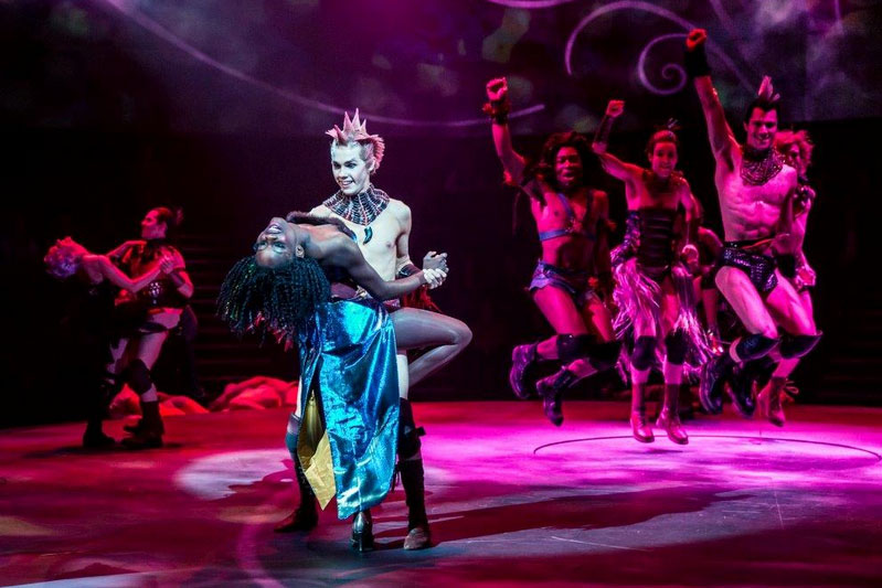 Puck (Michaelson) dances with the Fairy Queen (Kadri).