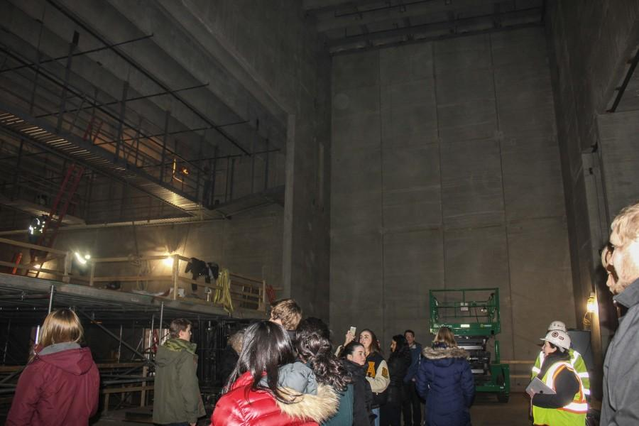 Students on the tour step on stage to listen to a short presentation from the Coordinators of Construction.