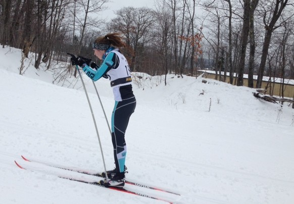 """Senior Ellen McCarthy skis in Houghton, Michigan. """"It is exciting to go and compete with my friends/teammates in a setting where everyone is serious about skiing,"""" McCarthy said."""