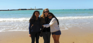Students visit Marbella Beach in Andalusia, Spain over Spring Break 2013 on the Spanish trip. From left to right are alums of class of 2014 Emma Chang and Claire Foussard, and senior Eva Perez-Greene
