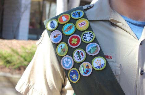 """Junior Tommy Monserud started out as a Cub Scout in elementary school, but now has numerous badges and is almost an Eagle Scout. """"It's pretty fun. I have a really tight-knit group,"""" he said."""