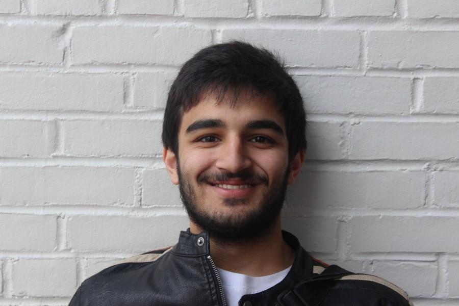 Senior Asad Masood smiles for the camera.