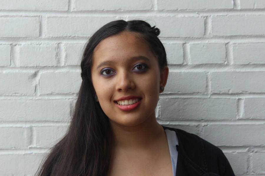 Senior Sandhya Ramachandran smiles for the camera.