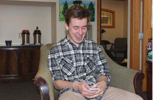 """Sophomore John Connelly listens to his music during his spare time. Many students use their mood as a guide for their music playlists. """"The music I listen to really emits my mood, like when I'm calm I won't listen to loud music because it doesn't feel right,""""  Connelly said."""
