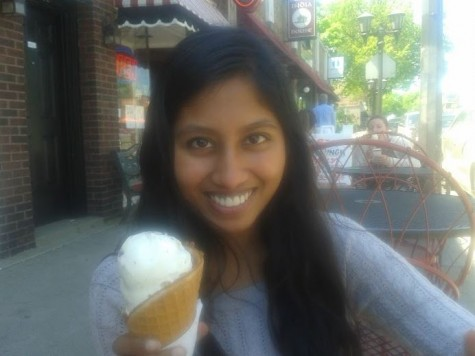 "Junior Navodhya Samarakoon holds an ice cream cone on a sunny afternoon while enjoying junior privileges.  Samarakoon and junior Maya Smith went out to lunch at Punch Pizza, then stopped at Grand Ole Creamery for ice cream. ""It felt like we were skipping school,"" Samarakoon said. ""It was nice to de-stress ourselves by eating ice cream and good food that we both enjoy, and just talking to each other,"" Samarakoon said."