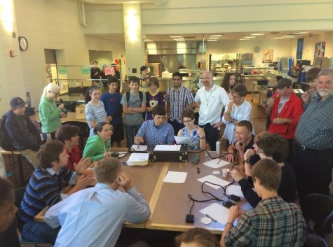 Quiz Bowl honed their skills for national competition at the annual students vs. teachers match on May 22.  Upper School science teacher Andrea Bailey, US English teacher Matt Hoven, US math teacher Carl Corcoran, and US history teacher Jon Peterson faced off against freshman Peter Blanchfield and sophomores Cole Thompson, Paul Watkins, and Ewan Lang in this round.  The competition was facilitated by Quiz Bowl sophomores Patrick Commers and Netta Kaplan.  The team goes on to compete at Nationals the weekend of May 29.