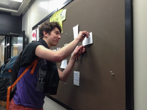 "Junior Milo Wittenberg pins his thank you note on the Thank You Board. ""I think it's important to have a forum in which to express one's gratitude because that so often goes unacknowledged in this community,"" Wittenberg said."