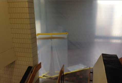 "The gym foyer is covered by plastic sheets, blocking from the construction. ""It smells like wood and it is kinda noisy, but as long as we keep the doors closed by the sophomore benches, I don't think anyone notices it too much,"" sophomore Lauren Hansen said."