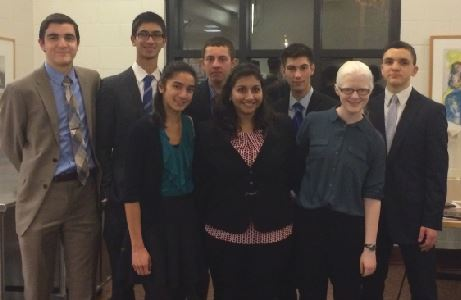 "Eight students from the debate team compete, four of whom wrote arguments for the rounds that have brought them to Elite 8 competition for International Public Policy Forum.  The students pictured are seniors Thomas Toghramadjian, Shaan Bijwadia, Afsar Sandozi, and Jordan Hughes,  junior George Stiffman, and sophomores Shefali Bijwadia, Sarah Wheaton, and Raffi Toghramadjian. The four seniors will compete in New York on May 2 . US Debate coach Tom Fones said, ""[I am most proud of] their ability to work together to produce written materials that are so coherent which have gotten them to this point. I mean the blending of their research, their writing, and the four of them working as a group has been exceptional."""