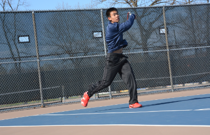 "Senior Eliot Tong slams a ball across the net at a match against The Blake School on April 22. "" Blake is a very tough opponent, but it is fun to play them,"" Tong said. The tennis team has an upcoming match on May 5, at home against Minnehaha Academy at 4 pm."