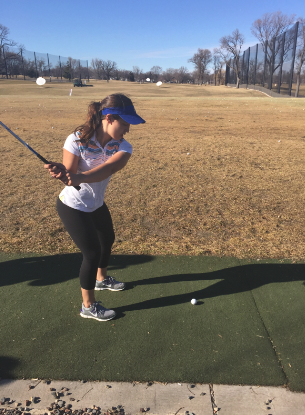 """Sophomore Maria Perkkio practices with her irons at the Highland Driving Range on April 9. """"Coach D has a great sense of humor  and she has really improved my swing,"""" Perkkio said."""