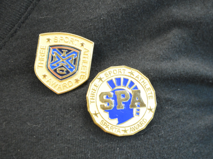 """ST. PAUL ACADEMY AND SUMMIT SCHOOL Sparta ATHLETES are awarded a set of pins at a recognition assembly to commemorate their hard work and impressive accomplishment. """"It is nice to see that sports are so highly acknowledged at SPA,"""" freshman Jesper Salverda said."""