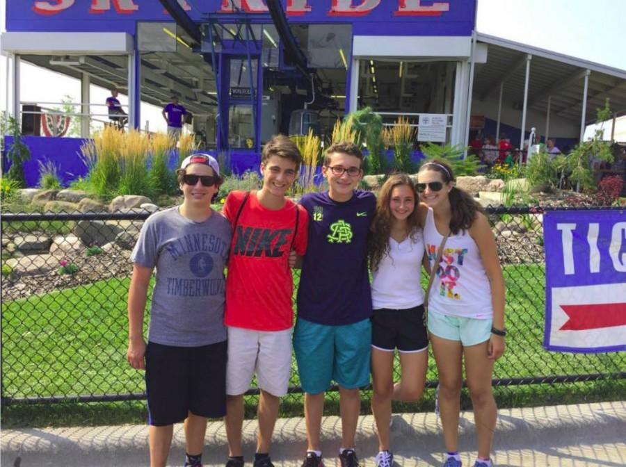 """Sophomore Ezra Cohen stands with friends at the State Fair. """"I always go on the giant slide,"""" Cohen said"""