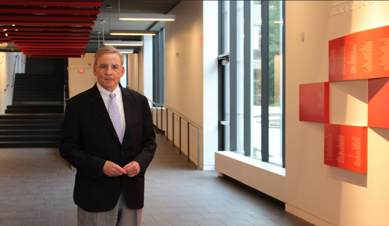 """Head of School Bryn Roberts poses in the RedLeaf Art Commons of The Huss Center for Performing Arts. """"We wanted to raise money for something we really needed for the students in the community,"""" Roberts said."""