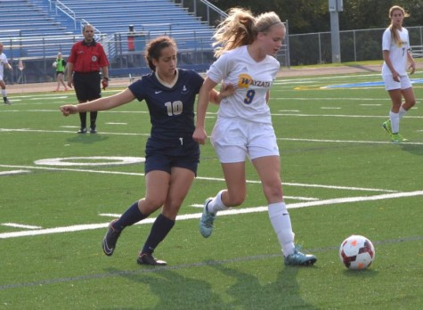 "SOPHOMORE DINA MORADIAN FIGHTS for the ball during their match against Wayzeta on Aug. 27. ""We've not gotten the results we've wanted now but sections are what counts. Don't underestimate us based on our record,"" junior Ella Matticks said."