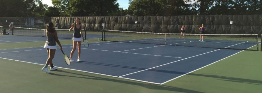 """JUNIOR NINA PERLEBERG AND AMODHYA SAMARAKOON compete in a doubles match against Cretin Derham Hall on Sept 10. The young team provides a new team dynamic in comparision to previous years. """"We have very similar teams in terms of our ability to play,"""" sophomore Isabel Brandtjen said."""