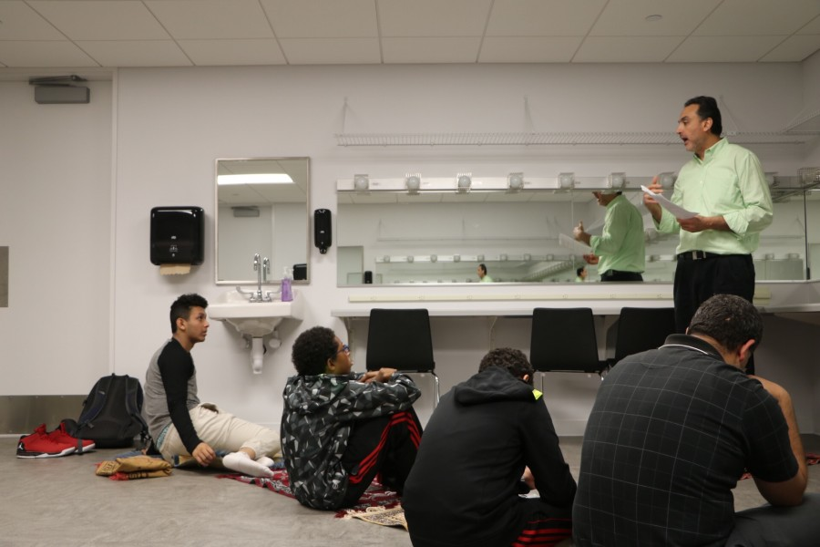 Students participating in the Friday prayer gather in the Huss Center's makeup studio every week.