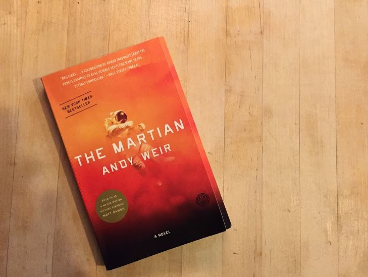 The cover of Andy Weirs The Martian.             The story revolves around the main character Mark Watney, a botanist, mechanical engineer, and the lowest ranking member of the Ares 3, the third mission to Mars. The story itself is gripping. It will keep you on your edge of your seat, junior Lauren Boettcher said.