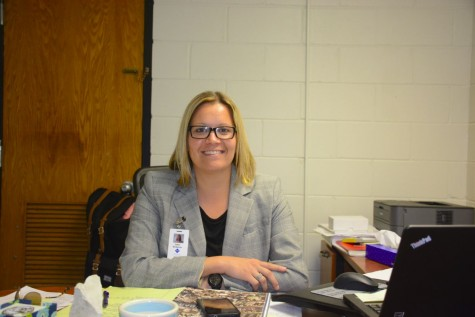 Dawn Wickstrum sits at her new desk at SPA.