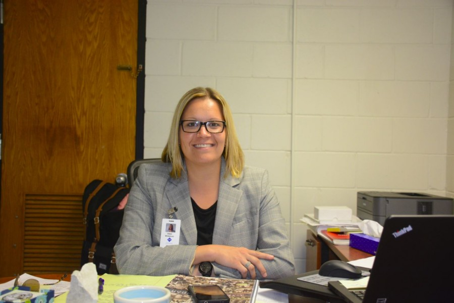 Dawn Wickstrum sits at her new desk at SPA. I want people to learn life lessons from the athletics at our school, Wickstrum said.