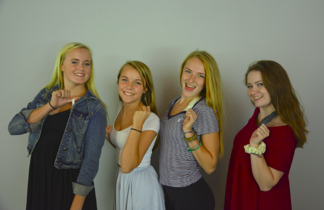 From left to right: sophomores Ashley Jallen and Sophia Rose, and seniors Lexi Hilton and Sabrina Brown model the new dress code.