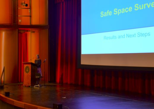 Upper School history teacher Nan Dreher presented formal results of the Safe Space survey to the student body.