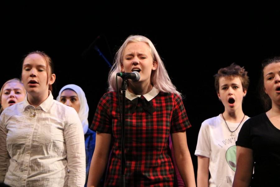 Junior Emily Schoonover sings her solo in