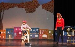 """Sixth grader Isabella Tunney (Debbie Fine) pedals to save her family and stop robbers, while seventh grader Maren Ostrem, Debbie's older self, narrates the adventurous story of Dizzy Fantastic. """"When Debbie learns that she can fly on her bicycle, she feels empowered to become Dizzy Fantastic, super hero!"""" Hueller said."""