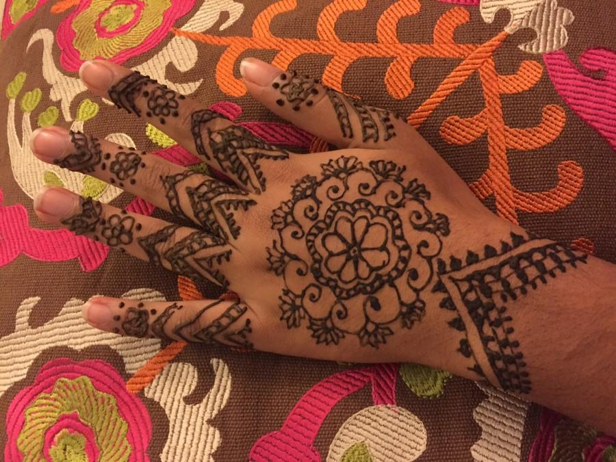 This hand models a henna design drawn by junior Tabeer Naqvis mother.  Henna makes me happy because it is a part of my culture and symbolizes joy, Tabeer said.