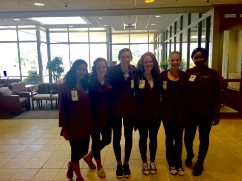 Junior Macy Blanchard stands with her volunteer group at Fairview Ridges Hospital.