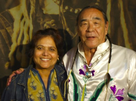 """Intercultural Club advisor Sushmita Hodges stands with Tom LaBlanc at the celebration of Indigenous Peoples Day which took place at the Pangea World Theater. """"This is a day that should not just be put on the calendar but should be recognized,"""" Hodges said."""