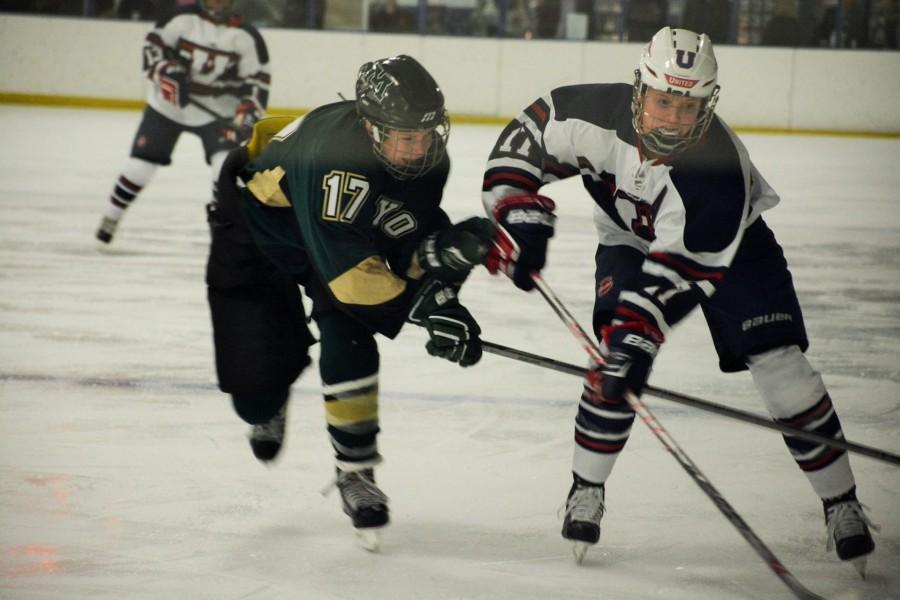 Sophomore Joie Phelps battles for a puck in the offensive zone. Phelps is third on the team with 38 points