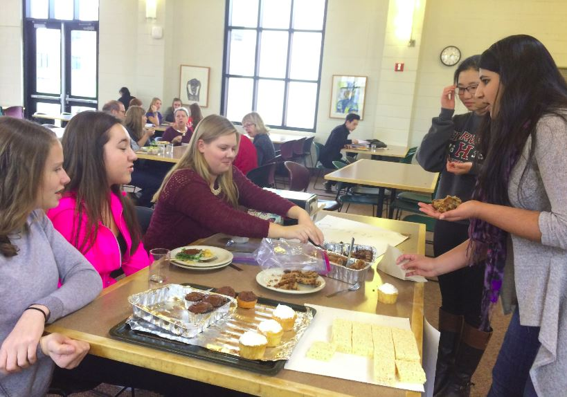 PAWS raises $310.10 in a bake sale for the Animal Human Society,