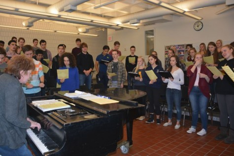 """THE ACADEMY CHORALE rehearses in preparation for the Dec. 4-5 Pops Concert. [The Huss Center] is a huge beautiful hall with incredible acoustics,"""" director of SPA choral activities Anne Klus said."""