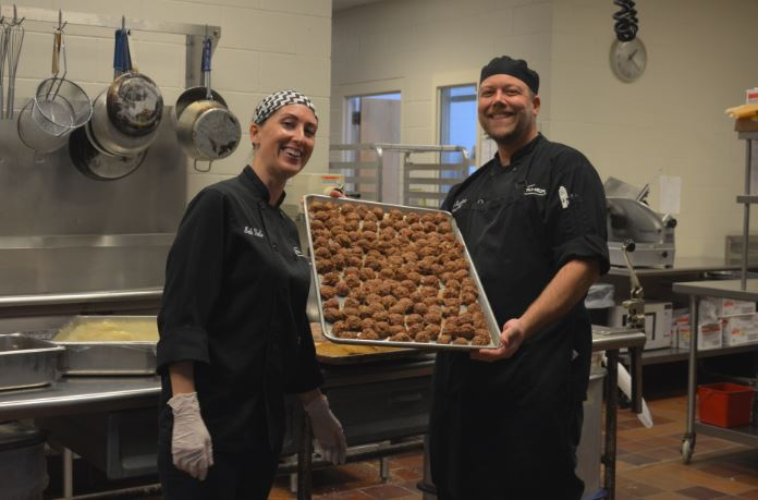 """Chefs Eric Swedberg and Beth Valle enjoy cooking for the SPA community. """"I really like how excited everyone is about the food,"""" Swedberg said."""
