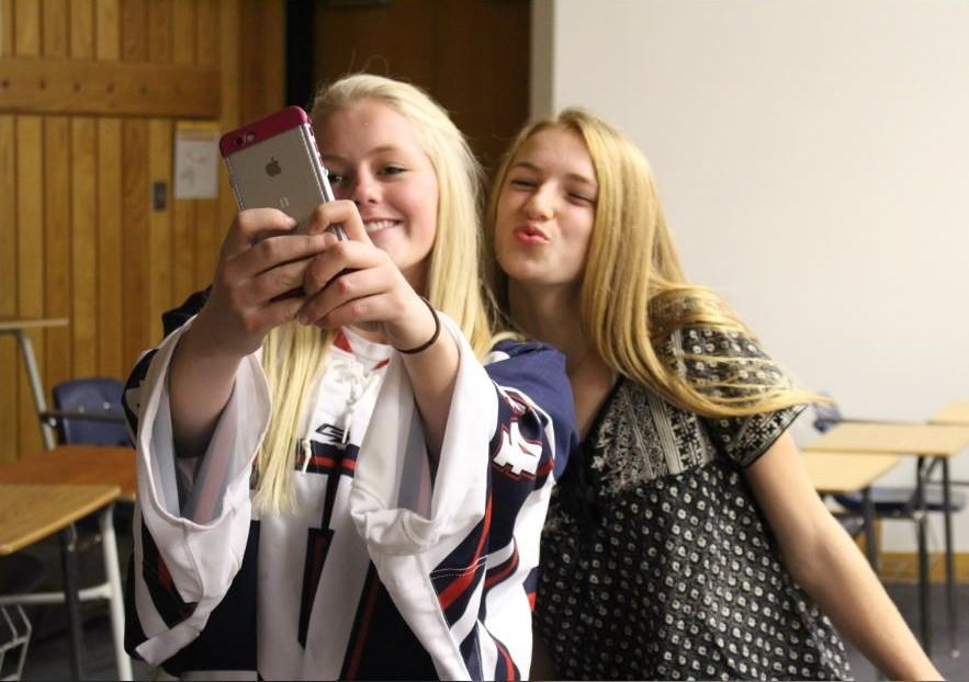 Seniors Catherine Johnson and Lexi Hilton take a selfie, keeping in mind the rules addressed in the new photo and video policy. The policy manifests itself in other aspects of Johson's school life, too.