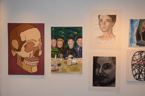 (Left to right) Painting by junior Ivan Gunther, Painting by senior Lauren Woessner, Painting by sophomore Lillian Pettigrew, Charcoal drawing by sophomore Sabrina Rucker
