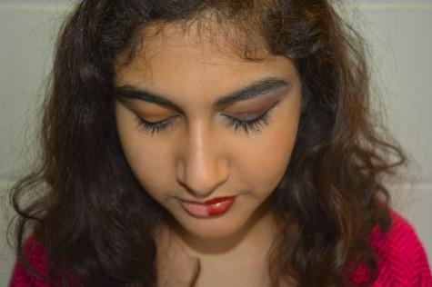 "Junior Heba Sandozi models for a #powerofmakeup picture, where half of her face has makeup and the other half is completely bare. ""There's this strange, but really cool phenomenon where wearing makeup can make you feel more confident,"" Sandozi said."