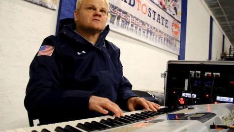 Hockey organist Russel Ebnet motivates with music