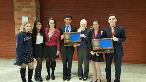 Debate team competitors pose for a photo after awards.  Pictured are seniors Liza Bukingolts, Navodhya Samarakoon and Maya Smith, sophomore Adnan Askari, and juniors Sarah Wheaton, Shefali Bijwadia and Raffi Toghramadjian.