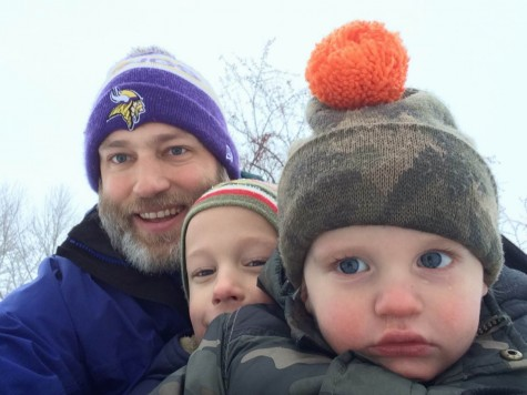 Upper School History teacher Jon Peterson takes a selfie while on a sled with his children.